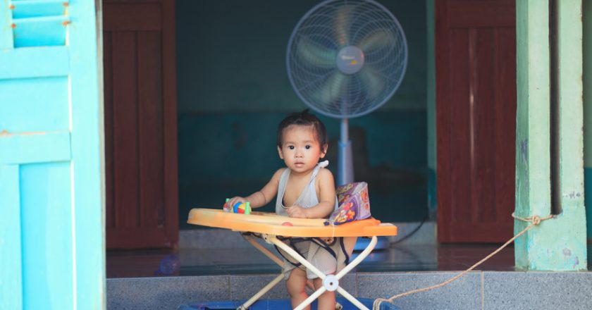 Asian child in baby walker