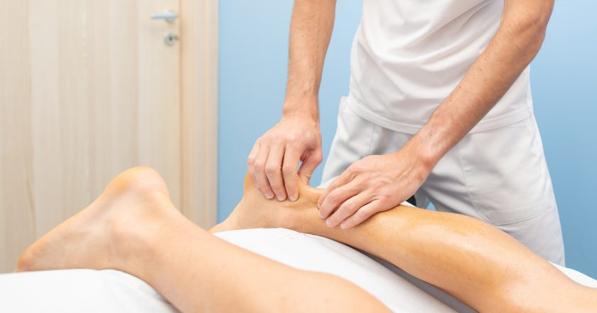 Physiotherapist during an Achilles tendon treatment