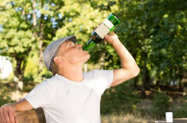 Alcohol abuser drinking from a bottle of wine