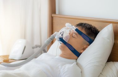 Obstructive sleep apnea therapy, Man wearing CPAP mask.