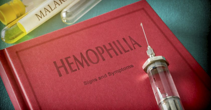 Vintage Syringe On A Book Of Hemophilia