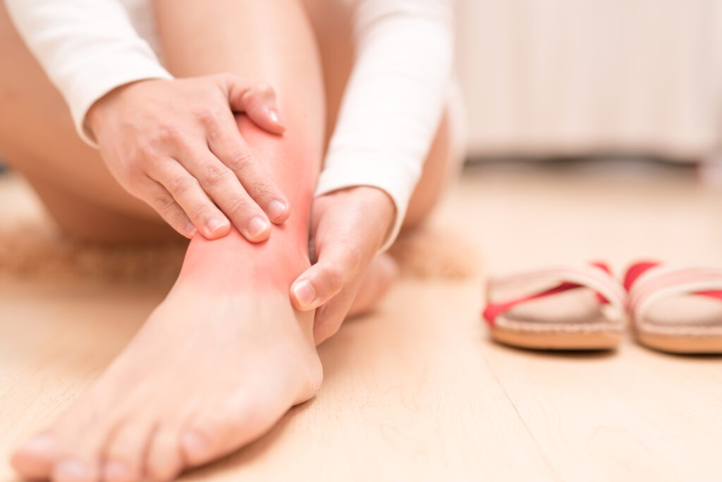 Leg ankle injury painful women touching the leg painful with red highlight on injure. healthcare and medical concept  