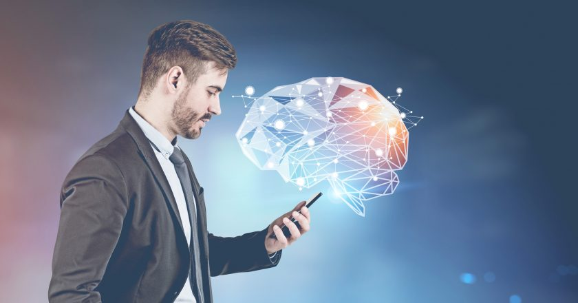 Businessman with smartphone, brain hologram |  |