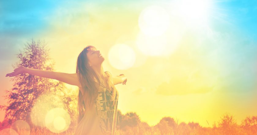 Happy girl enjoying the happiness on sunny meadow  