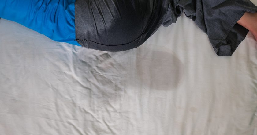 Bedwetting, or nocturnal enuresis in adults, pee on a white bed sheet or mattress in night sleep | νυχτερινή ενούρηση