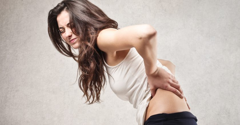 Woman with backache | © Bowie15 | Dreamstime Stock Photos