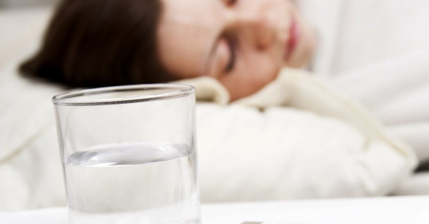 Girl lying near sick medicines | © Danil Chepko | Dreamstime Stock Photos