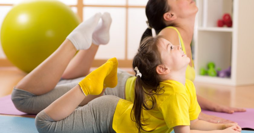 Mom and child doing gymnastics. Family sports | © Oksun70 | Dreamstime Stock Photos