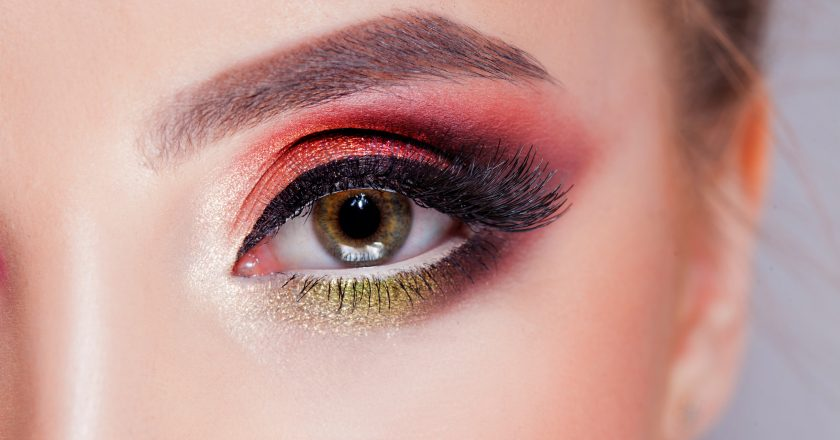 Amazing Bright eye makeup in luxurious scarlet shades. Pink and blue color, colored eyeshadow |