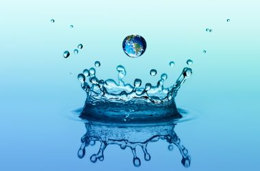 Water splash in crown shape and falling drop with earth image |