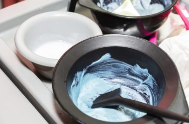 Hair dye in bowls and brush for hair coloring |