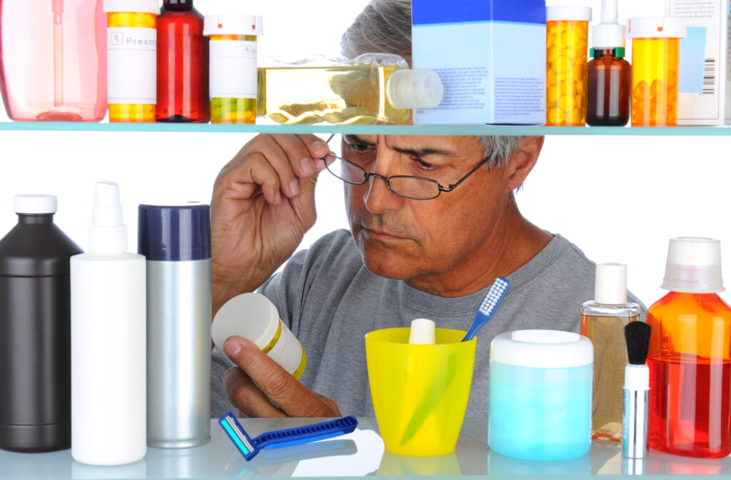 Middle aged man in front of medicine cabinet |