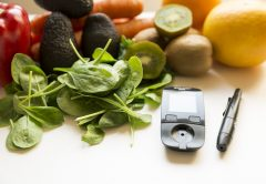 Diabetes monitor, diet and healthy food eating nutritional concept with clean fruits and vegetables with diabetic measuring tool | © Arturs Budkevics | Dreamstime Stock Photos