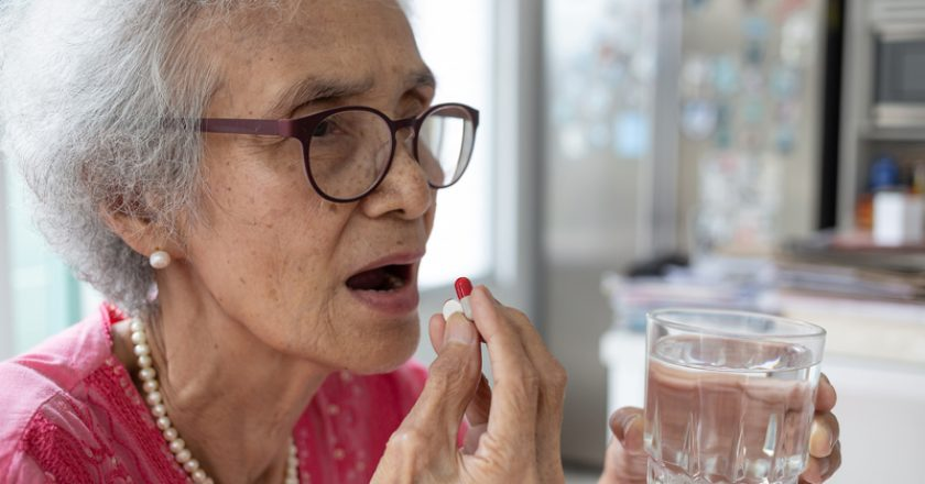 Asian elderly woman are taking and eating medicines and vitamins | © Satjawat Boontanataweepol | Dreamstime Stock Photos