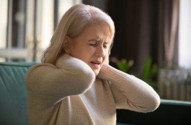 Tired upset old senior woman feeling stiff neck pain concept | © Fizkes | Dreamstime Stock Photos