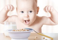 Baby Food. Happy Kid eating cereal milk, Strong Healthy Child | © Inara Prusakova | Dreamstime Stock Photos