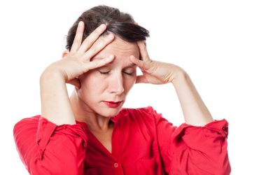 Exasperated young woman with exhaustion for headache | © Studio Grand Web | Dreamstime Stock Photos
