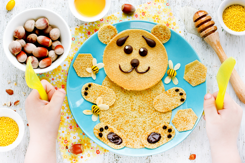Pancakes for baby breakfast. Bear pancakes with honey and nuts - | © Santusya | Dreamstime Stock Photos