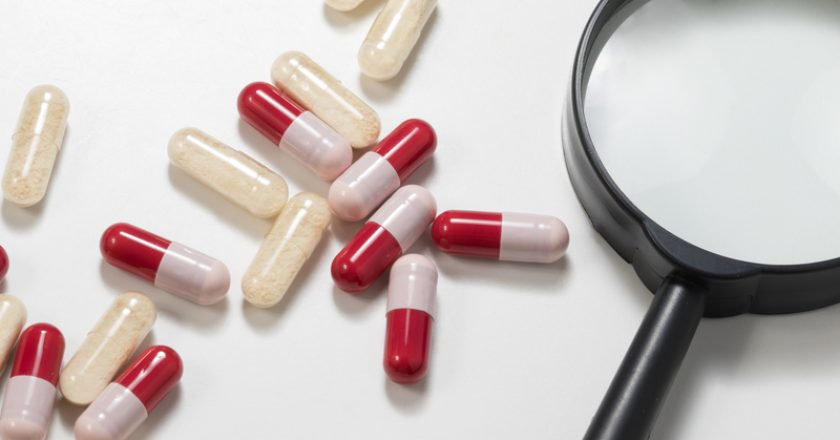 Group of antibiotics and probiotics capsule with magnifying gla | © Geza Farkas | Dreamstime Stock Photos
