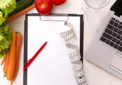 Healthy lifestyle concept. Writing weight loss plan with fresh vegetable diet and fitness | © Arturs Budkevics | Dreamstime Stock Photos