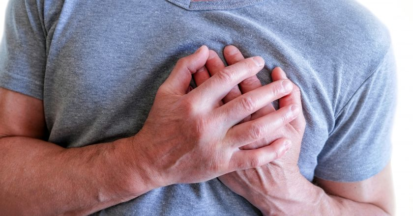 The man put his hands around the chest, pain in . Chest spasm, angina pectoris. Heart attack