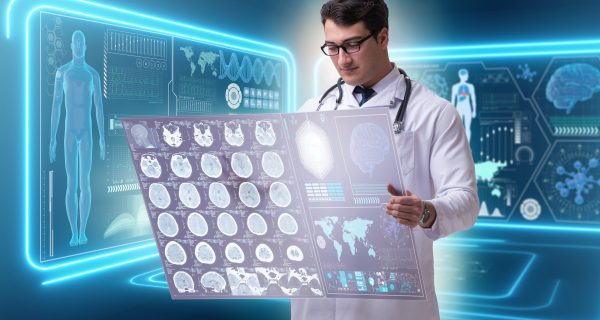 The male doctor studying results of brain mri scan |