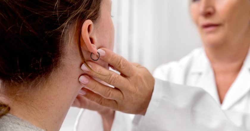 Checkup of patient´s lymph node, doctor sweeping for a flu or cold