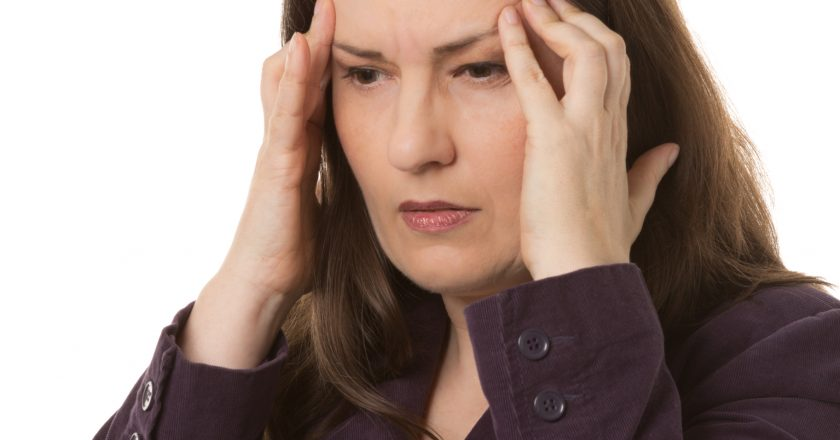 Woman with headache or migraine
