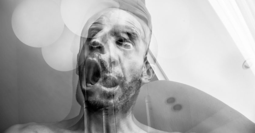 Man with suffocation and anguish of death, suffering of schizophrenia and mental disorder, mad man screaming | © Cyrnam | Dreamstime Stock Photos