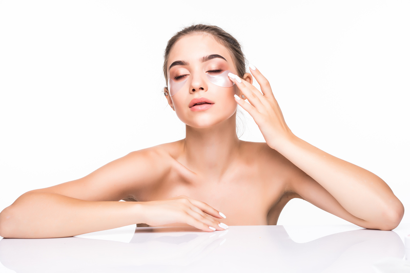 Portrait of beauty woman with natural make-up and hyaluronic acid hydrogel patches on fresh skin. Female face with mask under eyes   © Feightstudio   Dreamstime Stock Photos