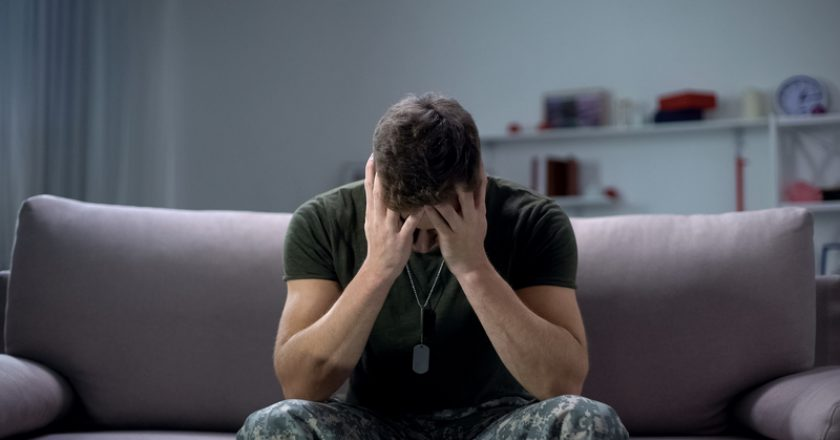 Nervous male military suffering depression, sitting alone at home, PTSD concept | © motortion | Dreamstime Stock Photos