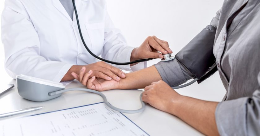 Doctor using stethoscope checking measuring arterial blood pressure on arm to a patient in the hospital, healthcare and medical | © Thitiphat1985photo | Dreamstime Stock Photos