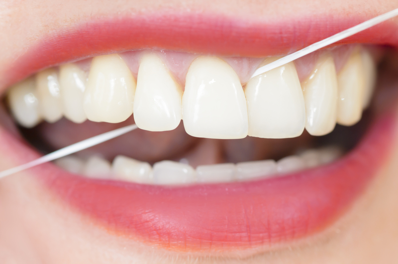 Using Dental Floss | © Oneblink | Dreamstime Stock Photos