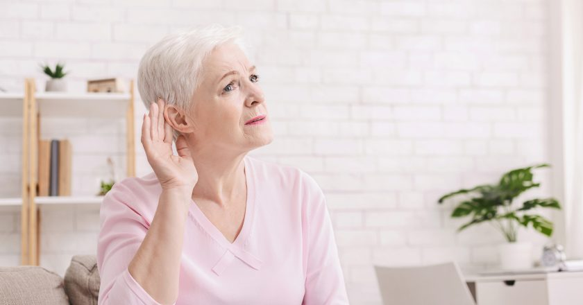 Elderly woman with hearing loss at home