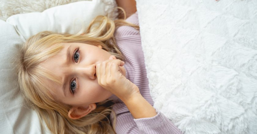 Sick child suffering from cough stock photo