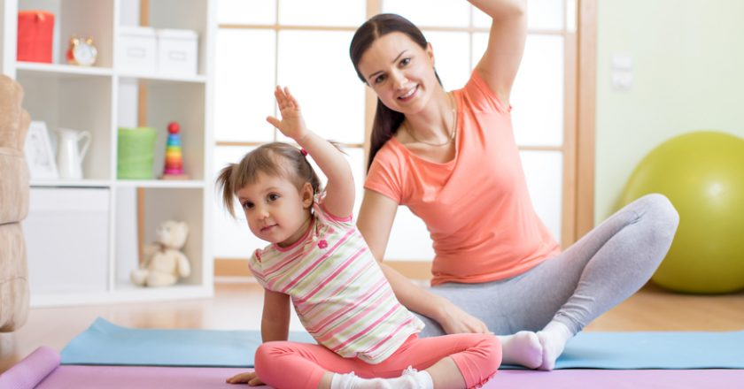 Active mother and child daughter are engaged in fitness, yoga, exercise at home | © Oksun70 | Dreamstime Stock Photos