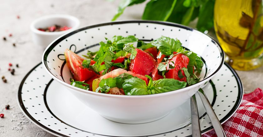 Tomato salad with basil and pine nuts in bowl - healthy vegetarian vegan diet organic food appetizer | © Timolina | Dreamstime Stock Photos