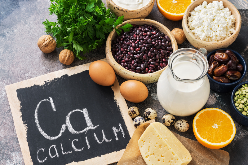 Food with calcium. A variety of foods rich in calcium. Signboard with the word-calcium. Top view. | © Kimkim1971 | Dreamstime Stock Photos