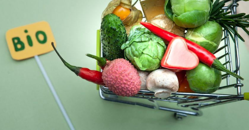 Health bio organic food concept, Shopping cart  in supermarket full of fruits and vegetables, .top view | © WildStrawberry_magic | Dreamstime Stock Photos