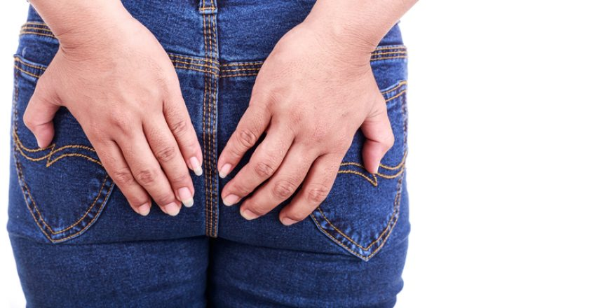 Close up woman's hand holding the backside : Concept hemorrhoids   © Phanuwatn   Dreamstime Stock Photos