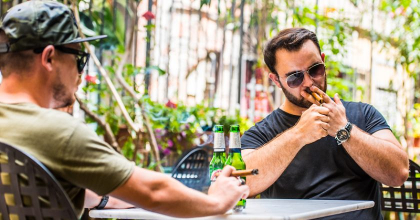 Drinking beers and smoking a cigar | © Karaul | Dreamstime Stock Photos