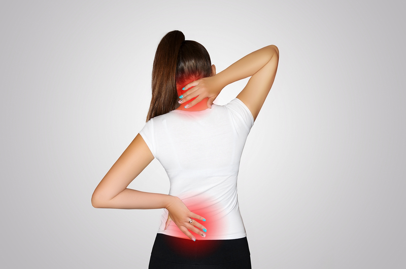 Pain in the neck and back. A young woman suffers from pain in the neck and back. Spine osteoporosis. Scoliosis. The place of pain | © Svetlana278 | Dreamstime Stock Photos