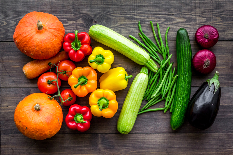 Base of healthy diet. Vegetables pumpkin, paprika, tomatoes, carrot, zucchini, eggplant on dark wooden background top |