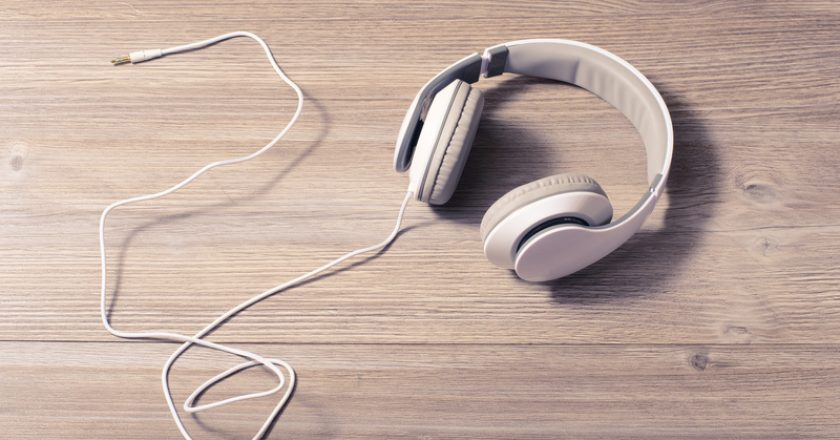 Modern tech technology track melody wire hobby rest relax lifestyle leisure chill out recreation tranquile concept. White headphon | © ActionGP | Dreamstime Stock Photos