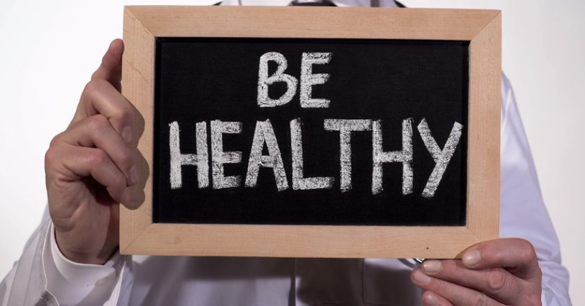 Be healthy text on blackboard in doctor hands, immune system, active lifestyle |