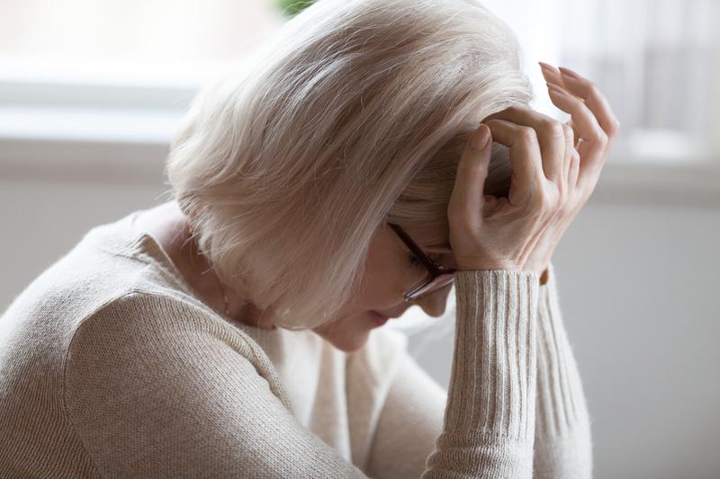 Elderly woman feeling unwell suffering from pain or dizziness   © Fizkes   Dreamstime Stock Photos