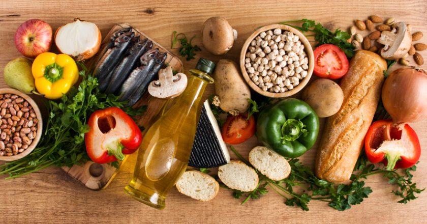 Healthy eating. Mediterranean diet. Fruit,vegetables, grain, nuts olive oil and fish on wood   © Chandlervid85   Dreamstime Stock Photos