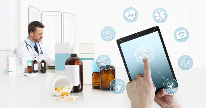 Internet healthcare and medical on mobile devices consultation, hand touch screen on digital tablet with symbols, doctor at desk |