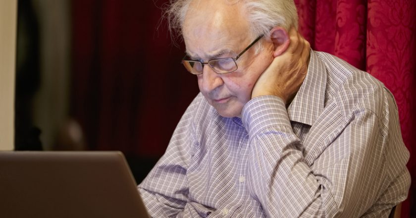 Old elderly senior person learning computer and online internet skills to prevent fraud |