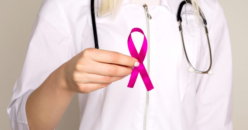 Female Doctor Holds Pink Ribbon, International Breast Cancer Day October 7 |